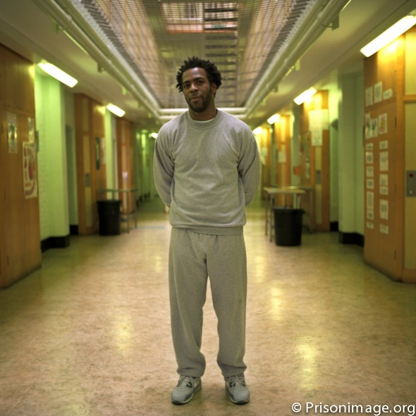 A young male prisoner stands on D wing of HMP Wandsworth prison. Credit: Andy Aitchison