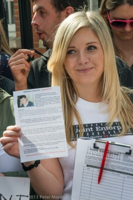 A woman holds up a flier about Jordan Cunliffe JENGbA (Joint Enterprise - NOT Guilty By Association) at start of march against the abuse of 'joint enterprise' by English and Welsh courts in London.