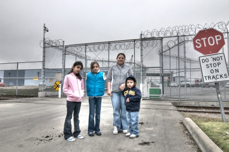 A family outside a US detention centre, similar to UK centres.  Source: Seattle Globalist, Flickr